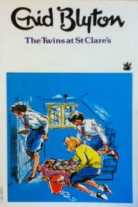 the twins at st clare's enid blyton cover art book stack